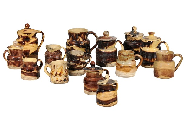 Set of 14 French Jaspe Pottery Creamers with Molted Mocha Finish, circa 1850